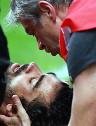 Yohann Huget of Toulouse receives treatment after suffering a knock on the head during the Heineken Cup match between Stade Toulouse and Leicester Tigers at Stade Municipal on October 14, 2012 in Toulouse, France.  Eoin Mundow/Cleva Media