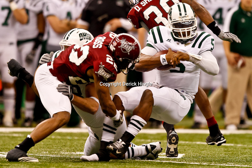 December 18, 2010; New Orleans, LA, USA; Troy Trojans cornerback Willard Ross (22) tackles Ohio Bobcats quarterback Phil Bates (5) during the first quarter of the 2010 New Orleans Bowl at the Louisiana Superdome.  Mandatory Credit: Derick E. Hingle