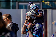 Tennessee Titans fan arrives with young son on his shoulders at the International Series match between Tennessee Titans and Los Angeles Chargers at Wembley Stadium, London, England on 21 October 2018.