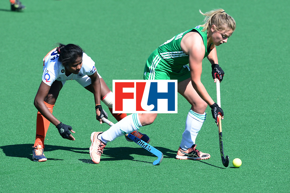 JOHANNESBURG, SOUTH AFRICA - JULY 22: Chloe Wathins of Ireland tackled by Namita Toppo of India during day 8 of the FIH Hockey World League Women's Semi Finals 7th-8th place match between India and Ireland at Wits University on July 22, 2017 in Johannesburg, South Africa. (Photo by Getty Images/Getty Images)