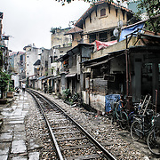 Houses and shops back up to train tracks in downtown Hanoi, Vietnam.
