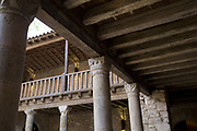 Architecture in the inner courtyard of the Abbot's Dwelling at the Abbey of Sante-Marie D'Orbieu, on 21st May 2017, in Lagrasse, Languedoc-Rousillon, south of France. Lagrasse is listed as one of France's most beautiful villages and lies on the famous Route 20 wine route in the Basses-Corbieres region dating to the 13th century.