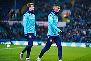 Leeds United defender Ben White (5) and Leeds United forward Patrick Bamford (9) warming up during the EFL Sky Bet Championship match between Leeds United and Cardiff City at Elland Road, Leeds, England on 14 December 2019.