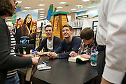 (L to R) Jake Abel, Max Irons and Chandler Canterbury of the upcoming film The Host sign autographs for fans at the Barnes & Noble on Northwest Highway in Dallas on Tuesday, March 12, 2013. (Cooper Neill/The Dallas Morning News)