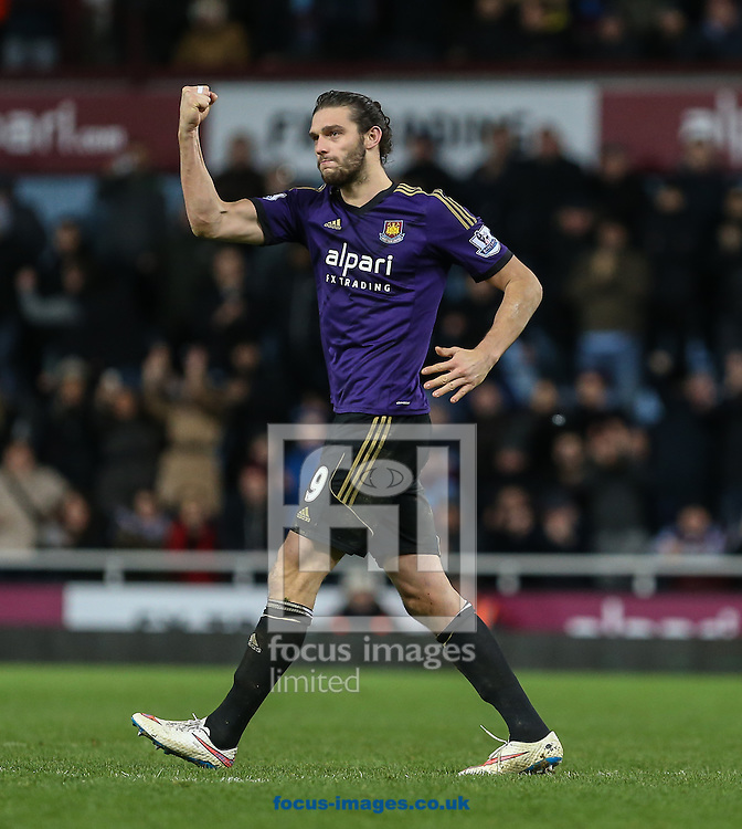 Andy Carroll of West Ham United punches the air after scoring in a penalty shoot out against Everton during the FA Cup match at the Boleyn Ground, London<br /> Picture by David Horn/Focus Images Ltd +44 7545 970036<br /> 13/01/2015