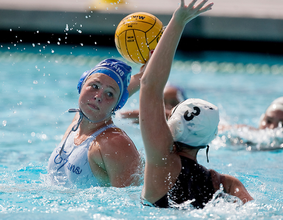 /Andrew Foulk/ For The Californian/ .Temescal Canyon's Lauren Thatcher, readies her self for a shot as Bonita's Jayne Reimel tries to block during the CIF Southern Section Division V girls water polo championship match.