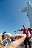 Tourist at the statue of Christ the Redeemer. Corcovado, Rio de Janeiro, Brazil.