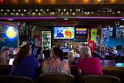 A handful of locals watch the approaching Hurricane Irma at Nickie's bar, Friday, Sept., 8, 2017, Tybee Island, Ga.  Irma is forecast to hit the island early next week. (Stephen B. Morton for The Atlanta Journal Constitution)