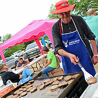 Sam Carpenter of Christian Chapel Church of Christ in Hatley cooks hamburgers for volunteers and community members.