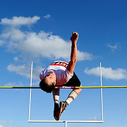 Jefferson City's Chris Verslues sails up and over the bar while competing in the boys high jump during the season opening track meet against Helias Catholic at Adkins Stadium on March 18.
