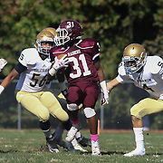 Concord Running Back Brandon Dennis (31) attempts to break a tackle in the second quarter Saturday, Oct. 17, 2015 at Concord Stadium in Wilmington.