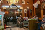 Arab men, smoke a nargileh in a cafe in east, Jerusalem, Israel