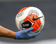 A gloved hand holds a disinfected match ball before the Premier League match at the Tottenham Hotspur Stadium, London. Picture date: 23rd June 2020. Picture credit should read: David Klein/Sportimage