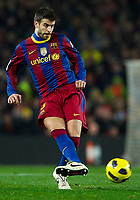 BARCELONA, SPAIN - NOVEMBER 29: Gerard Pique of Barcelona during the La Liga match between Barcelona and Real Madrid at the Camp Nou Stadium on November 29, 2010 in Barcelona, Spain. (Photo by Manuel Queimadelos/DPPI)