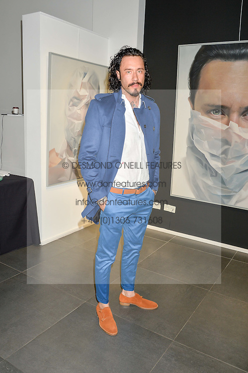 Artist MIKE DARGAS at a private view of woks by German artist Mike Dargas held at the Opera Gallery, 134 New Bond Street, London on 5th July 2016.