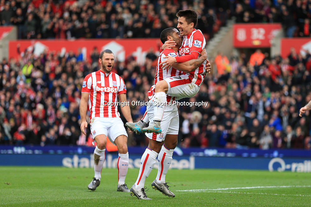 26th December 2015 - Barclays Premier League - Stoke City v Manchester United - Bojan Krkic of Stoke (R) celebrates with teammate Glen Johnson of Stoke after scoring their 1st goal - Photo: Simon Stacpoole / Offside.