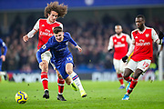 Chelsea midfielder Mason Mount (19) receives a tackle from Arsenal midfielder Mattéo Guendouzi (29) during the Premier League match between Chelsea and Arsenal at Stamford Bridge, London, England on 21 January 2020.