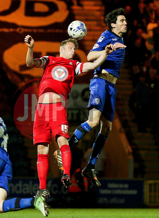Rochdale's Peter Vincenti challenges Nathan Clarke of Leyton Orient  - Photo mandatory by-line: Matt McNulty/JMP - Mobile: 07966 386802 - 21/04/2015 - SPORT - Football - Rochdale - Spotland Stadium - Rochdale v Leyton Orient - Sky Bet League One