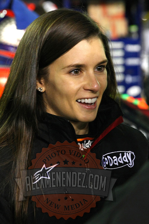 Race car driver Danica Patrick is seen on the starting grid prior to the NASCAR Sprint Unlimited Race at Daytona International Speedway on Saturday, February 15,  2014 in Daytona Beach, Florida.  (AP Photo/Alex Menendez)