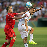 Lucas Leiva, (left), Liverpool, challenges Francesco Totti, AS Roma, during the Liverpool Vs AS Roma friendly pre season football match at Fenway Park, Boston. USA. 23rd July 2014. Photo Tim Clayton