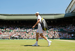 LONDON, ENGLAND - Wednesday, July 1, 2009: Ivo Karlovic (CRO) walks onto court before the Gentlemen's Singles Quarterfinal on day nine of the Wimbledon Lawn Tennis Championships at the All England Lawn Tennis and Croquet Club. (Pic by David Rawcliffe/Propaganda)