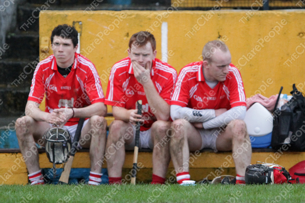 Dejected Fergus Kennedy, Ciaran Doherty & John Brigdale can only watch as  Na Piaraigh are presented with the Munster Club Senior Hurling Cup. - Photograph by Flann Howard