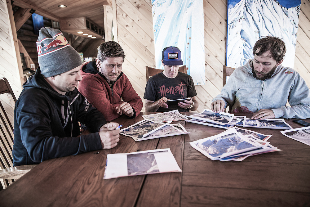 Jon Devore, Filippo Fabbi, Clark Fyans and Andy Farington study maps during the filming of The Unrideables in the Tordrillo Mountains near Anchorage, Alaska on April 19th, 2014.