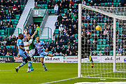 Ryan Porteous (#36) of Hibernian scores Hibernian's second goal (2-0) with a header from a free kick during the Ladbrokes Scottish Premiership match between Hibernian and Dundee at Easter Road, Edinburgh, Scotland on 24 November 2018.