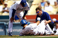 19 July 2009: Dodger Andre Ethier sits on the ground after being hit by the ball, being tended to by Manager Joe Torre and assistant athletic trainer Todd Tomczyk  during the MLB Los Angeles Dodgers 4-3 win over the Houston Astros on a warm summer day in LA at Chavez Ravine during a National League Professional Baseball game.