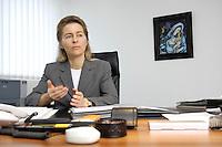 12 DEC 2005, BERLIN/GERMANY:<br /> Ursula von der Leyen, CDU, Bundesfamilienministerin, an ihrem Schreibtisch, in ihrem Buero, Bundesministerium fuer Familie, Senioren, Frauen, und Jugend<br /> Ursula von der Leyen, Federal Minister for family, Seniors, Women and Youth, in her office<br /> IMAGE: 20051212-01-00<br /> 1KEYWORDS: Büro