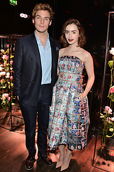 LILY COLLINS and SAM CLAFLIN at the Lancôme pre BAFTA party held at The London Edition, 10 Berners Street, London on 14th February 2014.