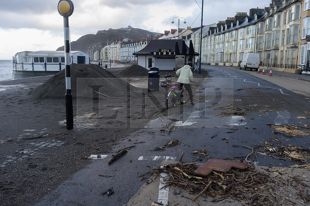© Licensed to London News Pictures. 12/02/2014. Aberystwyth, UK At first light the impact of the previous day's 100mph winds and high tides is clear to see on the promenade at Aberystwyth on the west wales coast. . Photo credit : Keith Morris/LNP