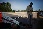 """DACULA, GA – JUNE 7, 2014: Karl Bushby checks his iPhone for directions before continuing on Highway 124. Bushy walks about 20 miles a day, and has admitted that his quest to get permission to travel through Russia is a long shot. """"If I skip Russia and just start walking through China, I've failed.""""<br /> <br /> Karl Bushby is trying to complete the longest walk in history. Unless the Russians stop him. As a 45 year-old Brit, Bushby been traveling around the world on foot since 1998. In the most recent leg of his journey, Bushby is walking to Washington, D.C. to petition the Russian Embassy to lift a visa ban that prohibited him from continuing his hike through Russia."""