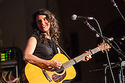 Singer-songwriter Lucy Kaplansky, who came to the New York folk scene in the 1980s on stage at the Folk City benefit concert at the Museum of the City of New York. The concert was held to support a forthcoming exhibit on the folk msusic revival in New York in the 1950s and 60s.