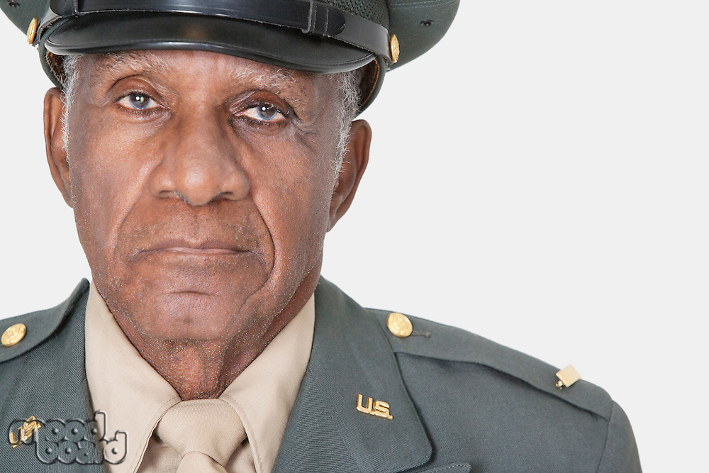 Close-up portrait of a senior male US military officer over gray background