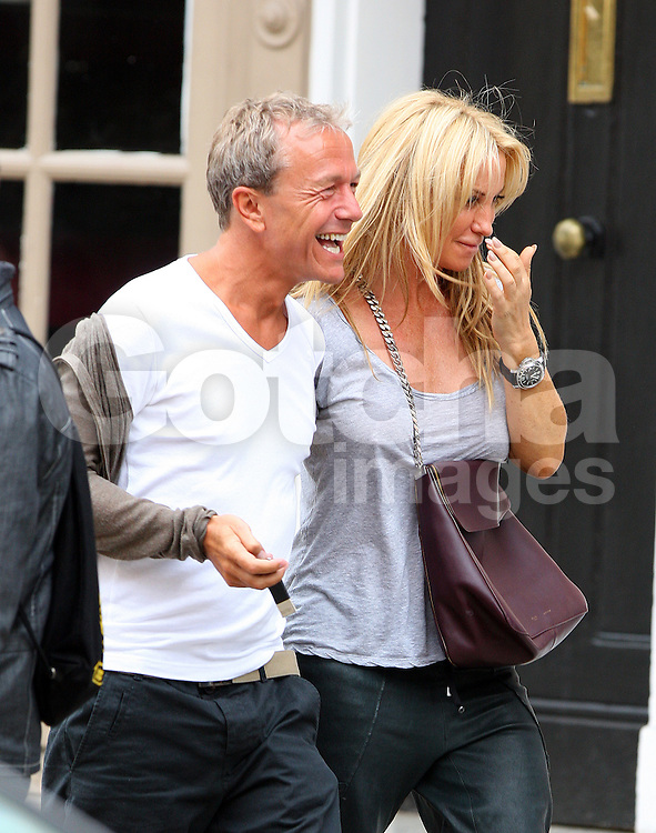 Meg Mathews out shopping with a mystery man in north London. Noel Gallagher's ex-wife wearing a grey t-shirt, pair of black 3/4 length trousers and black shoes was all smiles as she walks arm in arm around Hampstead with her man. London, UK. 15/08/2012<br />BYLINE MUST READ : JAMESY/GOTCHA IMAGES<br /><br />Copyright by © Gotcha Images Ltd. All rights reserved.<br />Usage of this image is conditional upon the acceptance <br />of Gotcha Images Ltd, terms and conditions available at<br />www.gotchaimages.com