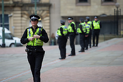 © Licensed to London News Pictures . 24/03/2016 . Bradford , UK . Police line the edge of the court precincts at Bradford Crown Court ahead of the arrival of ex England footballer Adam Johnson, where he is due to be sentenced following his conviction for  sexual activity with a 15 year old girl . Photo credit : Joel Goodman/LNP
