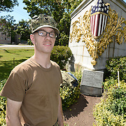 BANGOR Maine,  -- 8/8/15 - Builder 2nd Class Joshua Phillips of Gardiner, Maine poses at the USS Maine (ACR 1) Memorial in downtown Bangor on Saturday. Phillips, and four fellow reservists from Navy Operational Support Center, Bangor, spent the afternoon spreading mulch around the memorial's pathways. USS Maine, an armored cruiser commissioned in 1895, sank in Havana harbor in 1898, just prior to the Spanish-American War. (U.S. Navy Photo by Chief Mass Communication Specialist Roger S. Duncan / Released)