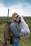 Keith Crowley with bagged caribou meat taken during Heidi Anderson's 2019 subsistence hunt in Alaska