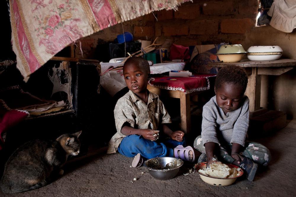 Jessica Mwiinga, husband Jobo, teenage granddaughter Dimitria and grand kids Natasha and Miaba. Habeenzu village, Zambia.