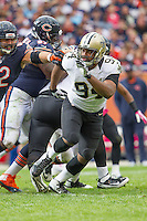 06 October 2013: Defensive end (94) Cameron Jordan of the New Orleans Saints rushes against the Chicago Bears during the second half of the Saints 26-18 victory over the Bears in an NFL Game at Soldier Field in Chicago, IL.