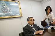 President and CEO of Elpida Memory Inc, Yukio Sakamoto, in his offices (and holding a silicon wafer made by Elpida), Tokyo, Japan, on Friday 29th  June 2007.