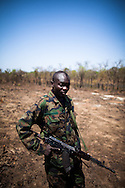 A UPDF soldier stands guard at a landing pad the troops hacked into bush.