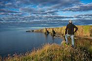 Europe, United Kingdom, Scotland, Highlands, Isle of Skye,  John O'Groats, Duncansby Head , man at coastline (MR)