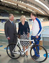 The Prince of Wales and Duchess of Cornwall talk to cyclist Barney Storey during a tour of the Olympic Park velodrome in London Wednesday, 13th June 2012.  Photo by: i-Images