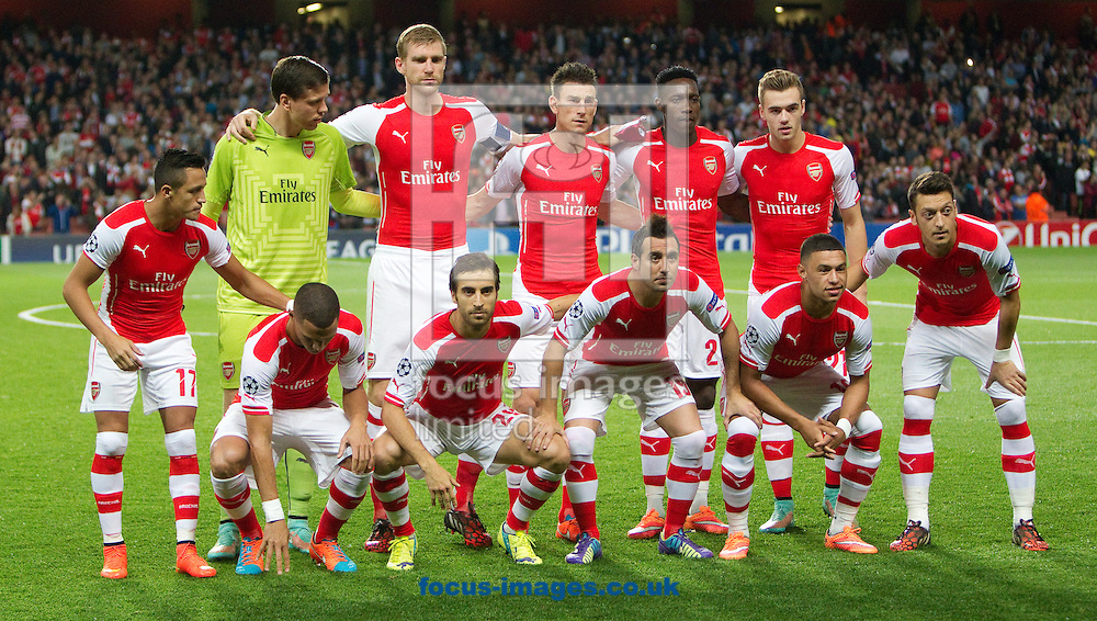 Arsenal line up for a team photograph before kick-off against Galatasaray in the UEFA Champions League match at the Emirates Stadium, London<br /> Picture by John Rainford/Focus Images Ltd +44 7506 538356<br /> 01/10/2014