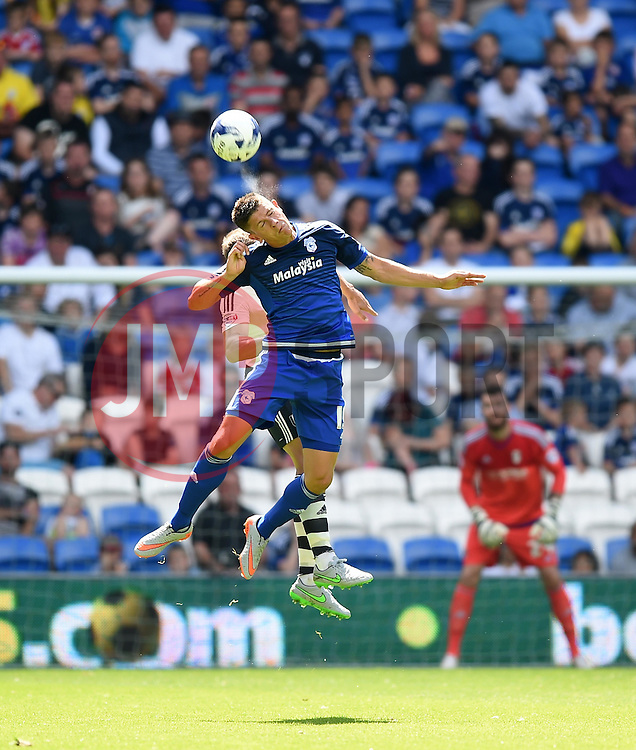 Alex Revell of Cardiff City heads the ball - Mandatory by-line: Paul Knight/JMP - Mobile: 07966 386802 - 08/08/2015 -  FOOTBALL - Cardiff City Stadium - Cardiff, Wales -  Cardiff City v Fulham - Sky Bet Championship