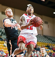 NCAA Basketball: Wofford pulls away from VMI in the second half to take an 81-63 win - VMI's QJ Peterson eludes Wofford's Matthew Pegram to score for the Keydets.  VMI fell to the visiting Terriers, 81-63, in Lexington on Wednesday night.