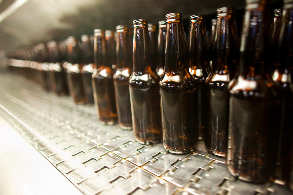 London, Ontario ---11-04-19--- Clean bottles emerge from a bottle washer at Labatt London Brewery April 19, 2011, one of many places in the brewing process that Labatt has implemented technology to help conserve water.<br /> GEOFF ROBINS The Globe and Mail