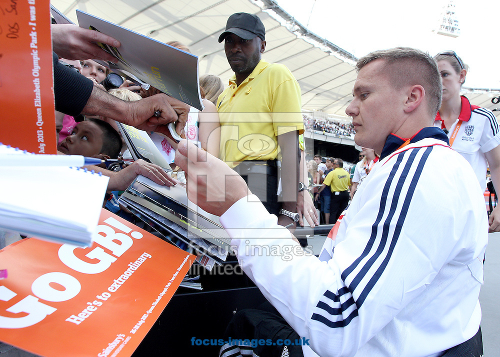 Picture by Paul Terry/Focus Images Ltd +44 7545 642257<br /> 28/07/2013<br /> David Weir signs autographs during the Sainsbury's International Para Challenge on day 3 of the Anniversary Games at Queen Elizabeth Olympic Park, London.